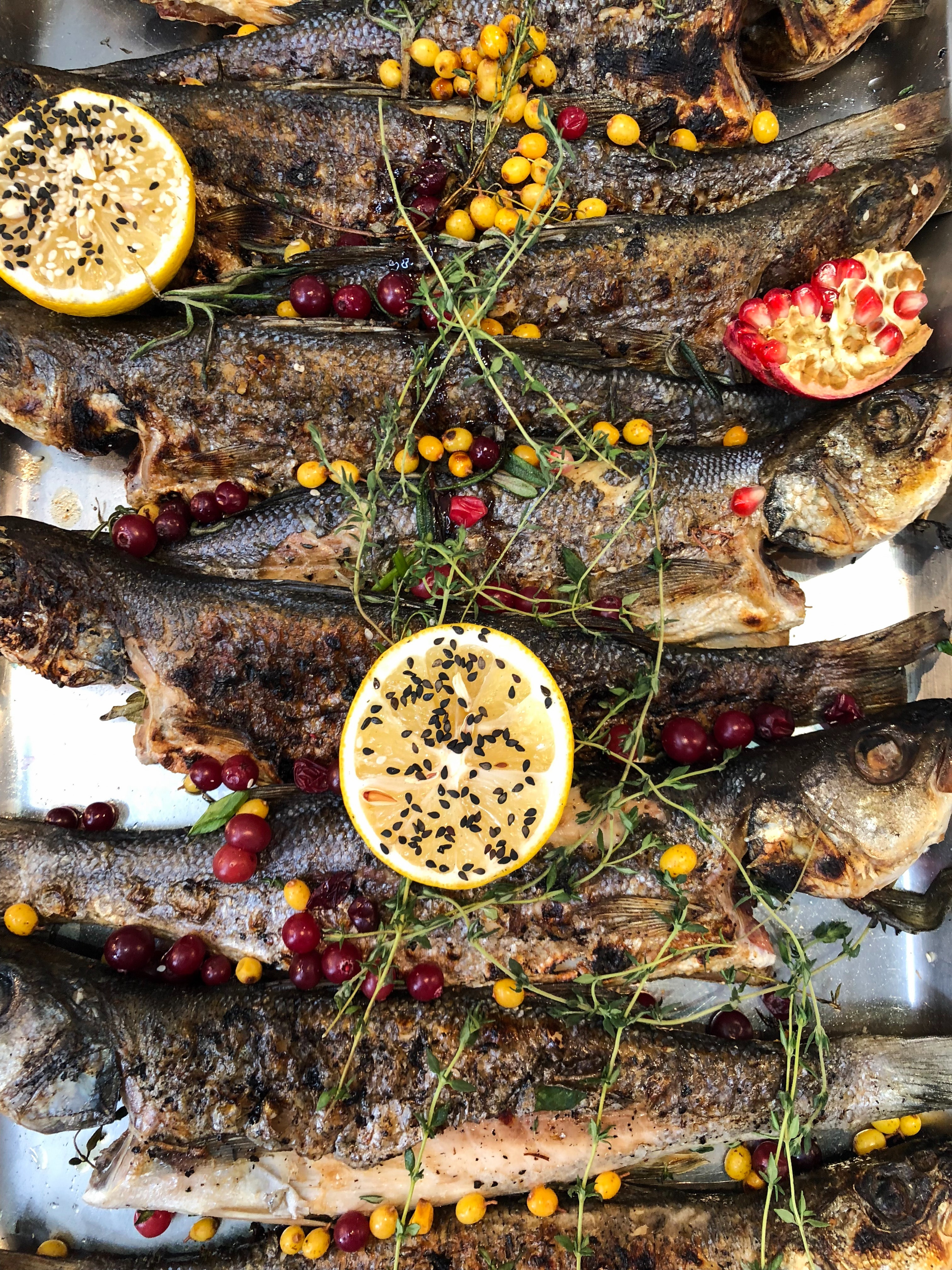 marinated fish feast of fish at Christmas Eve dinner Italy Italian tradition herbs lemon tray seasoning