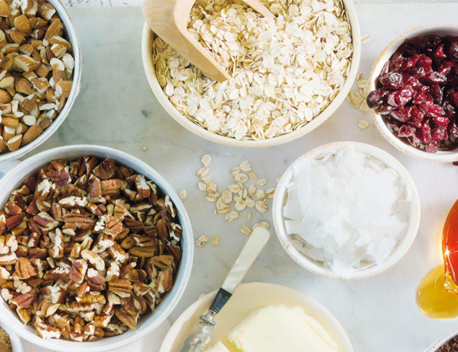 pantry staples oats oatmeal porridge bowl white table honey salt almonds walnuts breakfast ingredients