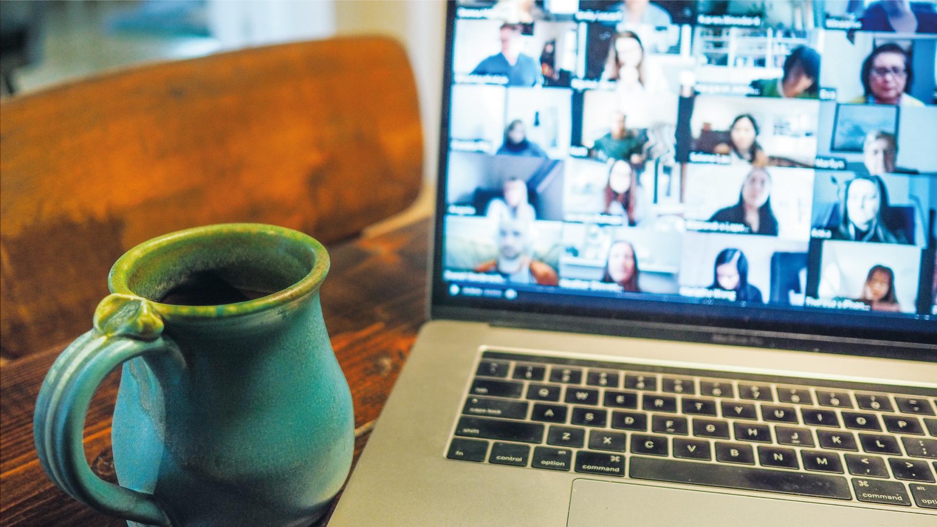 laptop coffee table mug facetime zoom virtually connect language program exchange
